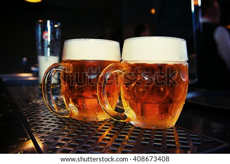 big Beer glass on a bar table, closeup - stock photo