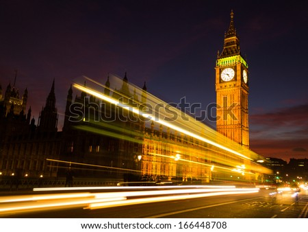Big Ben and a light trail at dusk - stock photo
