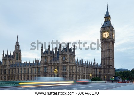 Big Ben and bridge in the early morning, car passing lights in London, natural colors - stock photo