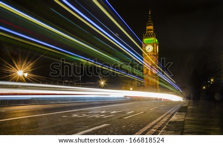 Big Ben and House of Parlament at dramatic night with light trails on Westminister bridge, London, United Kingdom