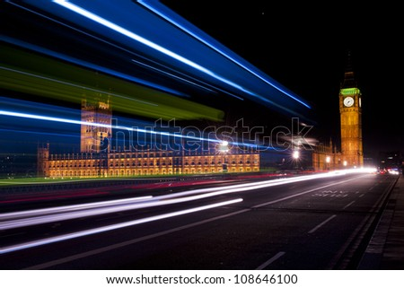 big ben and house of parliament seen through the traffic lights - stock photo