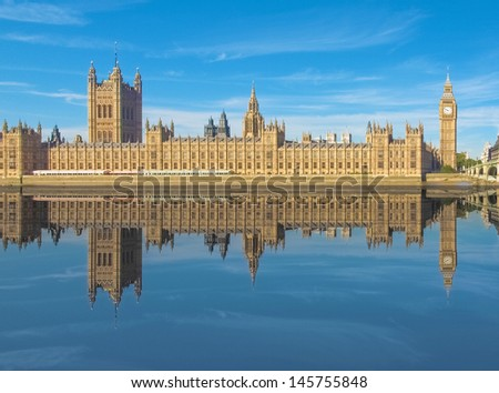 Big Ben and Houses of Parliament Westminster Palace in London reflected in River Thames - stock photo