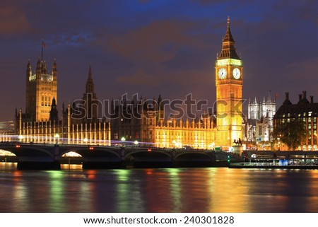 Big Ben and Houses of Parliament with blur ships on thames river at night, London, United Kingdom, UK