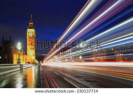 Big Ben and London at night with the lights of the cars passing by after rain, the most prominent symbols of both London and England - stock photo