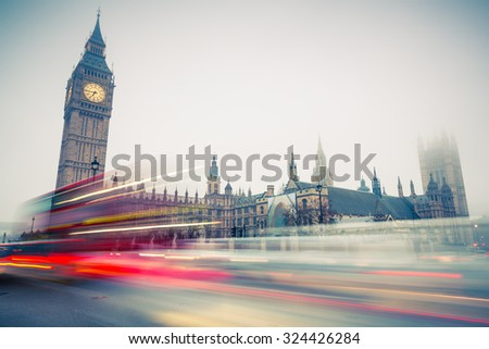 Big Ben and moving double-decker bus in London, UK - stock photo