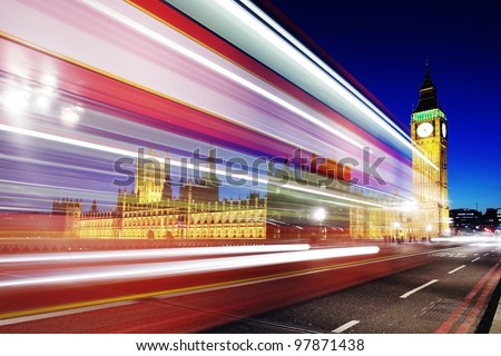 Big Ben and Parliament at night with trail lights - stock photo