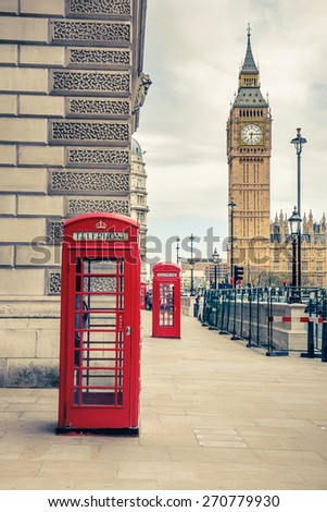Big Ben and phone booths in London - stock photo