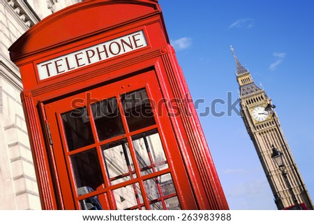 Big Ben and Red Phone Booth in Pariament Square in London - stock photo