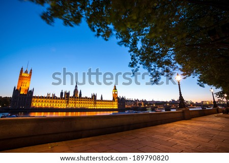 Big Ben and the Houses of Parliament in London at night - stock photo