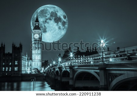 Big Ben and the Houses of Parliament in London with full moon - stock photo