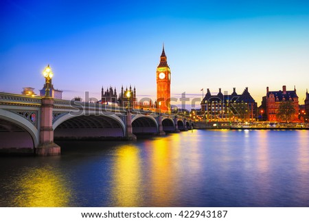 Big Ben and westminster bridge in London at sunrise.