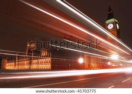 Big Ben at night with bus in motion blur. - stock photo