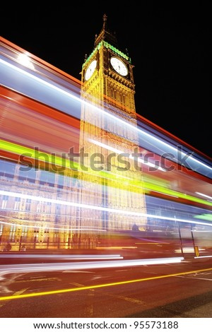 Big Ben at night with bus in motion blur - stock photo