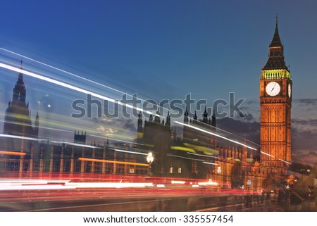 Big Ben at twilight with traffic lights - shot from Westminster Bridge - stock photo