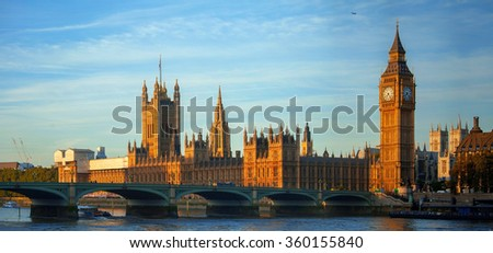 Big Ben Clock Tower Against Blue Sky England United Kingdom - stock photo