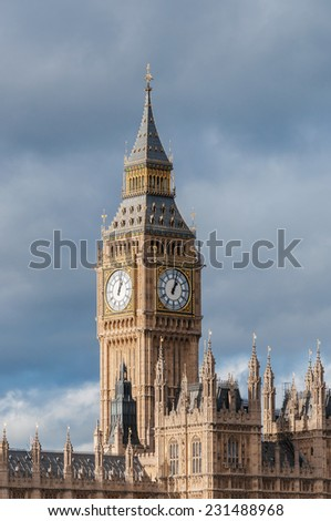 Big Ben Clock Tower in London against cloudy sky - stock photo