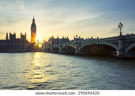Big Ben clock tower in London at sunset, UK. Special photographic processing. - stock photo