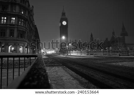 Big Ben in London in stormy winter - stock photo
