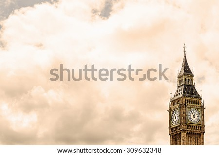 Big Ben in London, UK against cloud's sky background. Image with selective focus and toning - stock photo