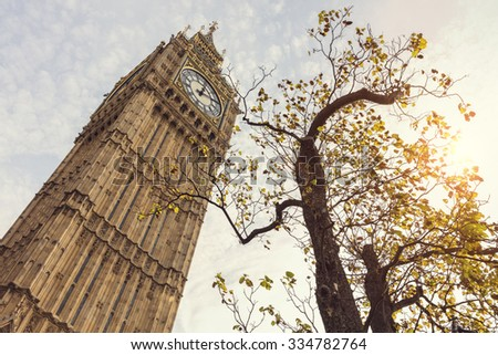 Big Ben in London UK low angle in autumn sunshine - stock photo