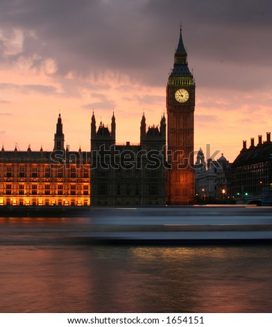 Big Ben just after sunset with speeding boat - stock photo