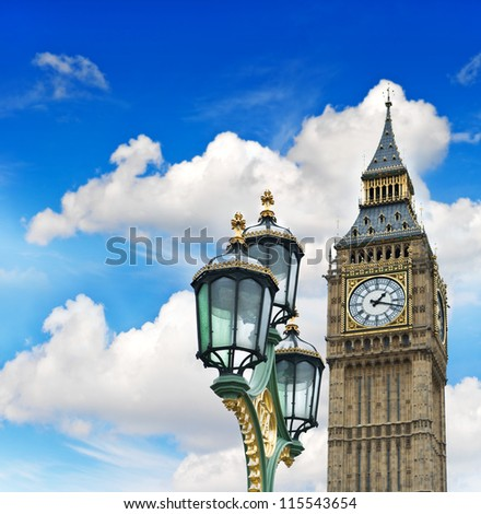 Big Ben over cloudy blue sky. House of Parliament in London - stock photo