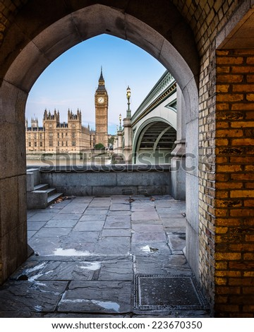 Big Ben, Queen Elizabeth Tower and Wesminster Bridge framed in Arch, London, United Kingdom - stock photo