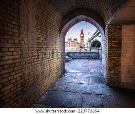 Big Ben, Queen Elizabeth Tower and Wesminster Bridge framed in Arch, London, United Kingdom - stock photo
