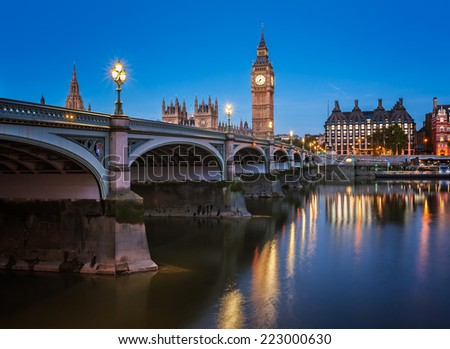 Big Ben, Queen Elizabeth Tower and Wesminster Bridge Illuminated in the Morning, London, United Kingdom - stock photo