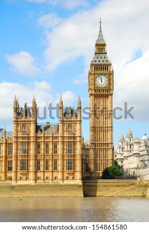 Big Ben Tower and part of the Houses of Parliament in London - stock photo