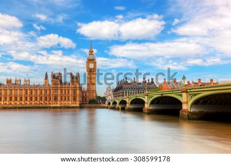 Big Ben, Westminster Bridge on River Thames in London, England, UK. English symbol. Sunny day with puffy clouds - stock photo