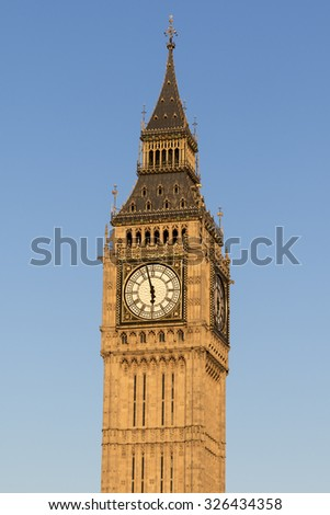 Big Ben with a blue sky background - stock photo