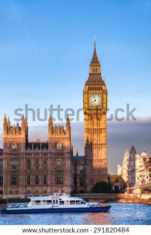 Big Ben with boat in London, England, UK - stock photo