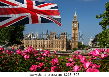 Big Ben with full park of roses in London, UK - stock photo