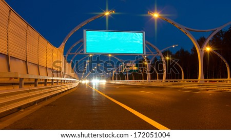 Big billboard on night highway - stock photo
