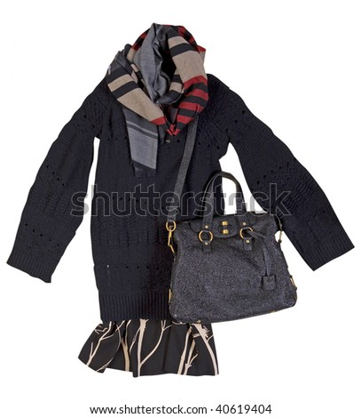 big black long warm winter sweater, knitted jacket checkered scarf skirt and shiny velvet bag with sequins - stock photo