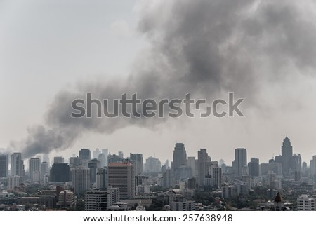 Big black smoke over Bangkok - stock photo
