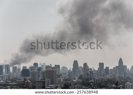 Big black smoke over Bangkok - stock photo