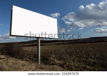 Big blank billboard in filed and sky with clouds  - stock photo