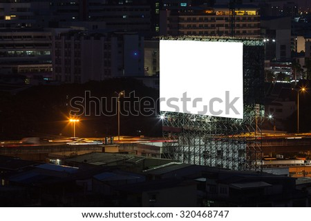 Big blank billboard with cityscape background.