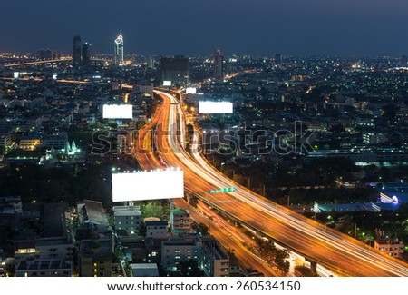Big blank billboard with expressway and cityscape at twilight time - stock photo