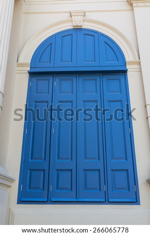 big blue window in European style architecture