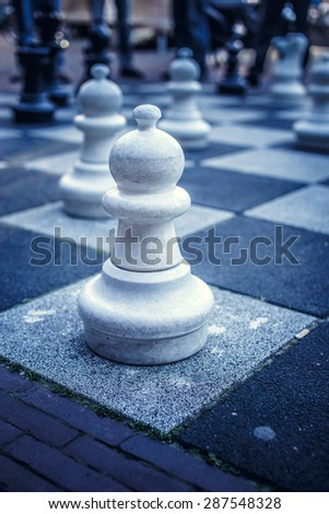 Big board with chess on the street. - stock photo