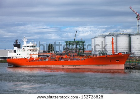 Big boat sailing in the harbor - stock photo