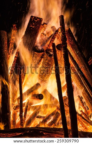 Big bonfire at night. Fire flames on black background - stock photo