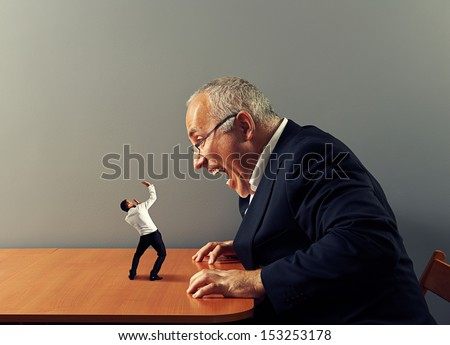 big boss is screaming at bad worker - stock photo