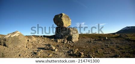 Big boulders on mountain plateau panoramic photo, Valdresflye, Jotunheimen, Norway - stock photo