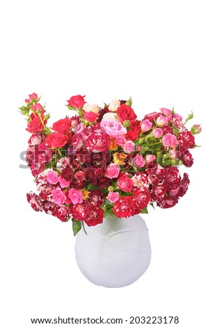 Big bouquet of pink roses in glass vase isolated on white.