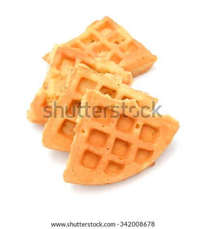 Big bowl of crunchy waffles isolated over white background, top view - stock photo