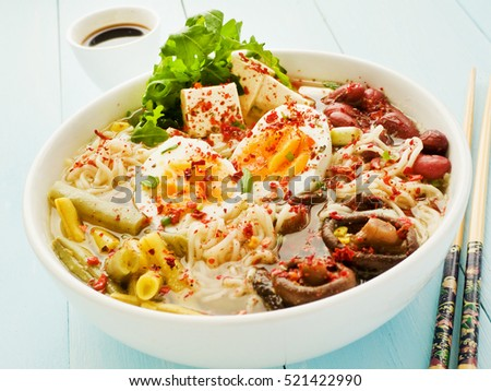 Big bowl of ramen with different ingredients. Shallow dof.